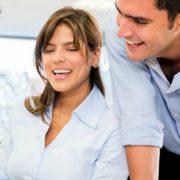 Happy team of four employees enjoying benefits of management training
