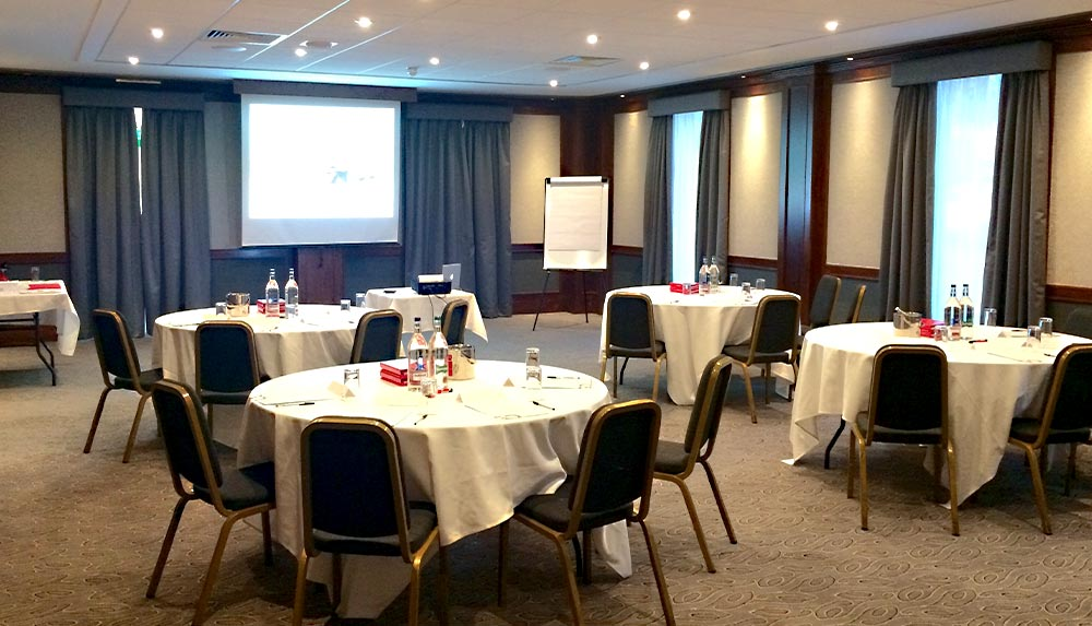 Table layout and projector set up for management courses in glasgow